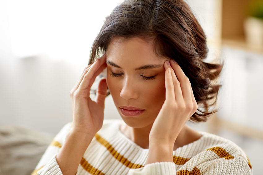 woman suffering from migraine headache